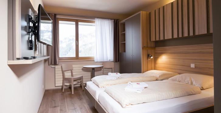 Doppelzimmer / © JUFA Hotels - JUFA Hotel Malbun Alpin Resort - Skipauschale